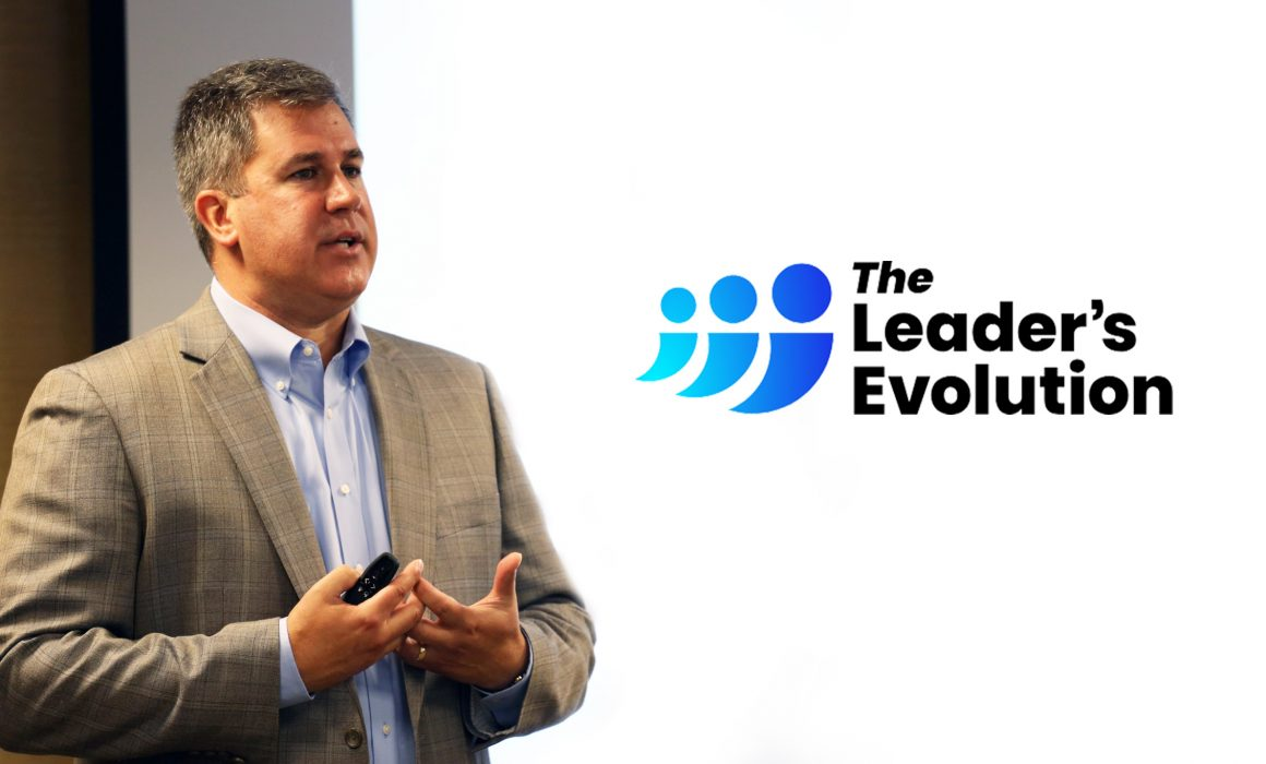 Ken Warman with The Leader's Evolution logo